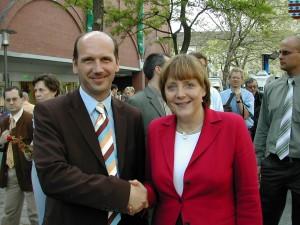 Aribert Wolf mit Kanzlerin Angela Merkel